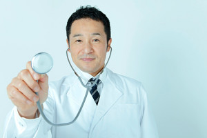 Male doctor using stethoscope